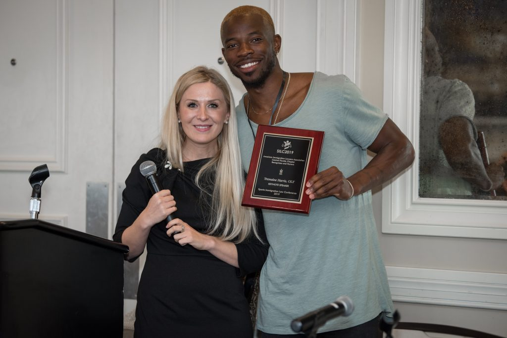 The Sports Visa Lawyer Ksenia Maiorova and Tremaine Harris, OLY at the Sports Immigration Law Conference